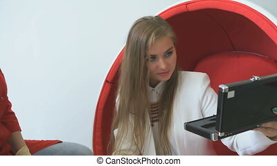 Young woman client looking at teeth tones variety - Young...