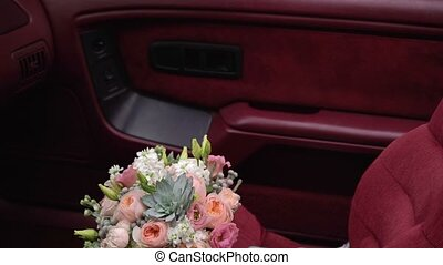 Bouquet flowers on car seat