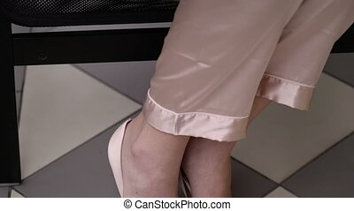 Woman legs in pink pants and shoes
