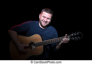 Portrait of a smiling man with guitar