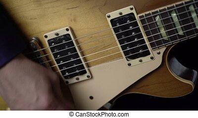 Artist playing guitar fast on concert closeup - Artist...