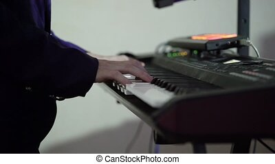 Artist playing keyboard on concert shot