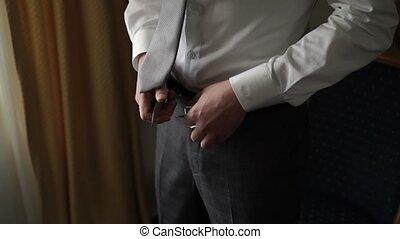 Man wearing belt close up shot