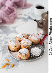 Little Sultana Muffins Dusted with Icing Sugar, copy space...