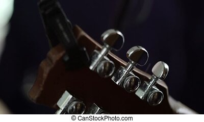 Neck of the guitar on concert close up shot