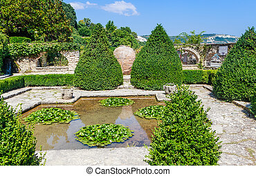 Pond with white lilies. Botanical Garden in Balchik. The territory of the palace of the Romanian Queen Maria. Bulgaria.