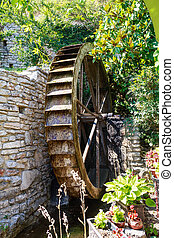 The old mill wheel. The territory of the palace of the...
