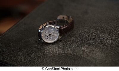 Man taking wrist watch shot