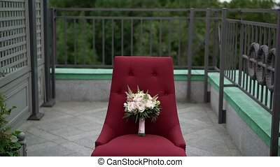 Bouquet on red chair