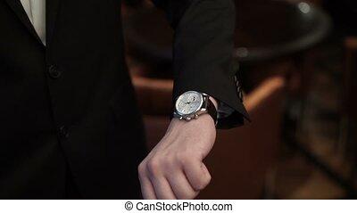 Man wearing wrist watch shot
