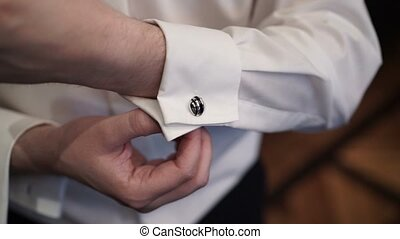 Man wearing cufflinks closeup shot