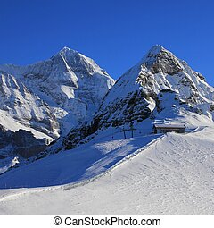 Snow covered mountains Monch and Lauberhorn - View from the...