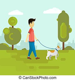 Young man walking with dog in the park.
