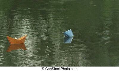 Two paper boats adrift in the river
