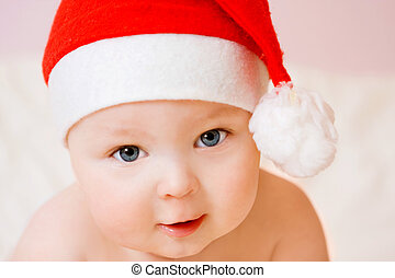 baby in christmas hat - portrait of sweet baby in christmas...