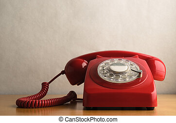 Retro Red Telephone on Light Wood Veneer Table - Eye level...