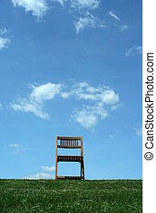 Wooden chair on a hilltop