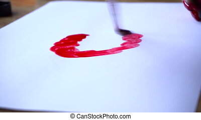 watercolor artist draws on clean white paper red abstract pattern