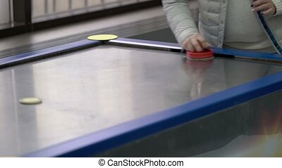 People playing air hockey closeup shot