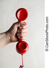 Hand Holding Out Red Retro Telephone Handset - Retro red...