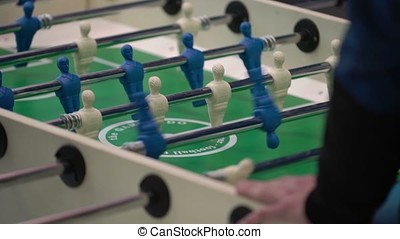 People playing table football shot