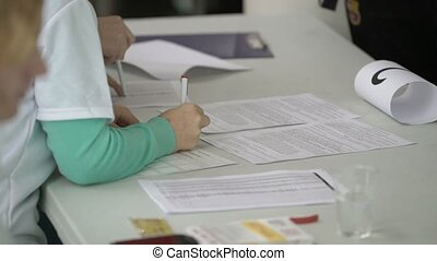 Woman filling documents closeup shot