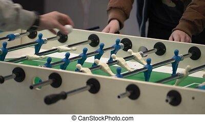 Guys playing table football shot