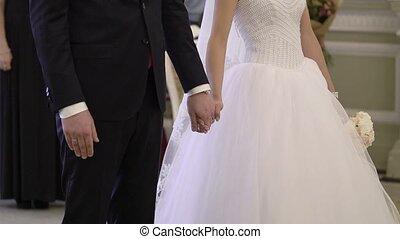 Wedding ceremony newlyweds holding hands shot