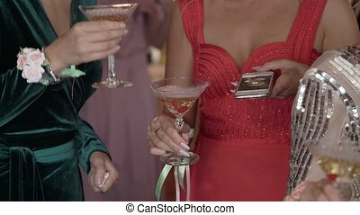 Womans with champagne on a party shot
