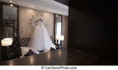 Wedding dress in hotel room shot