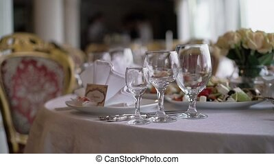Glasses on a table in restaurant shot