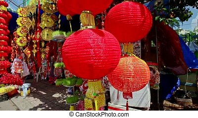 Wind Shakes Large Chinese Lanterns on Street Market in City...