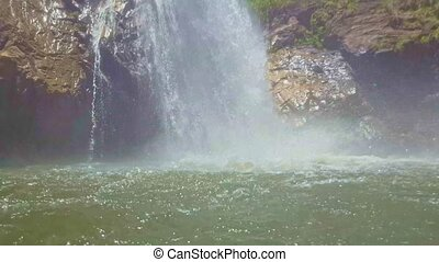 Powerful Waterfall Makes Splashes on Pond Surface