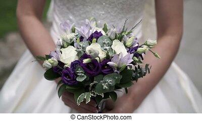 Bouquet in bride hands shot