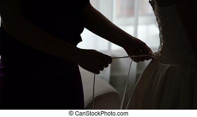 Wearing wedding dress silhouette