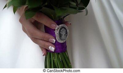 Bouquet in bride hand shot