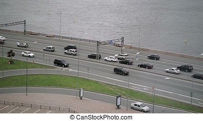 Cars on road near water shot
