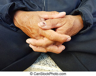 closeup  asian hands clasped together