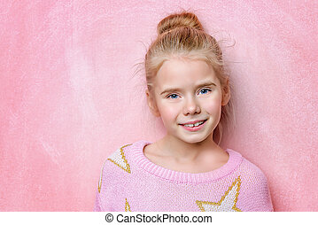 lively child - Portrait of a happy smiling girl over pink...