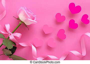 Beautifu rose with handmade heart and ribbon on pink...