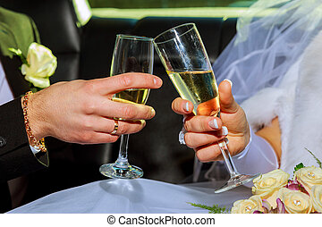 Womans and mans wedding hands with glasses. the couple...
