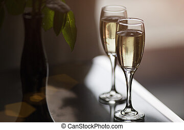 two glasses with champagne in cafe