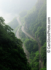 Curved Rock Mountain Road. Epic Mountain Landscape - Photo...