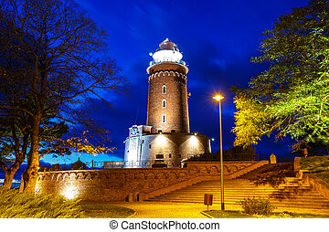 Night view of harbor and the lighthouse in Kolobrzeg, West...
