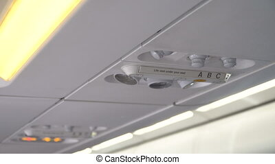 Airplane interior, signs on an airplane.