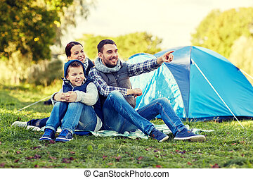 happy family with tent at camp site - camping, tourism, hike...