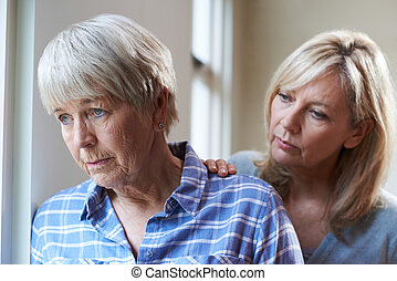 Serious Senior Woman With Adult Daughter At Home