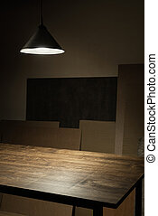 table top - Lamp hanging over empty wooden table in workshop