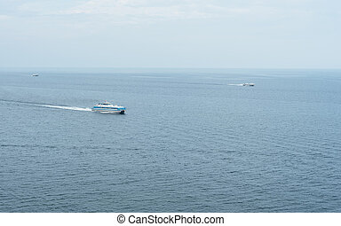 Three ships sailing in the sea. - Three different ship...