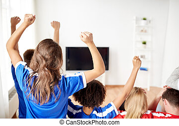 friends or football fans watching tv at home - friendship,...